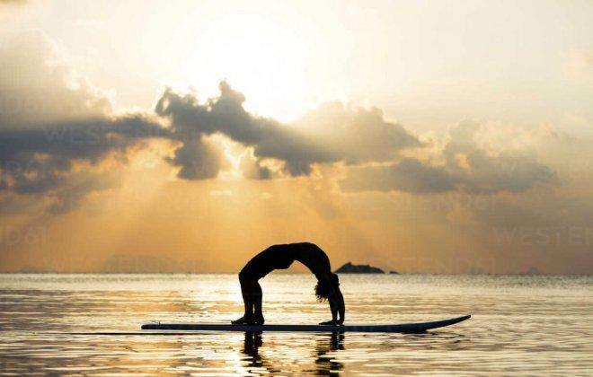 thailand-man-doing-yoga-on-paddleboard-at-sunset-bridge-position-SBOF000177.jpg